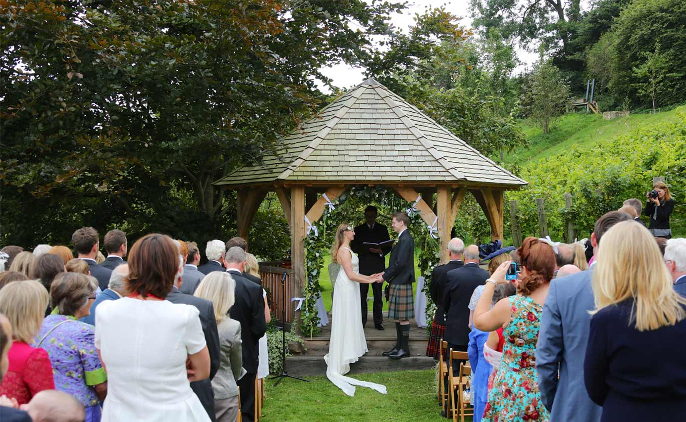 Longhouse weddings - wedding by gazebo