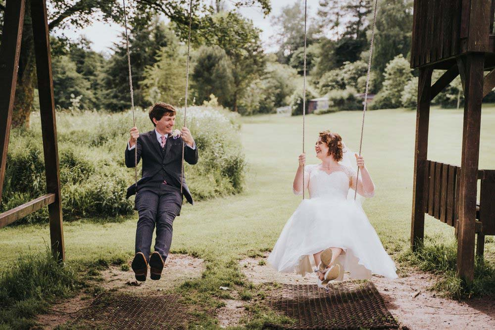 Newlyweds on swing
